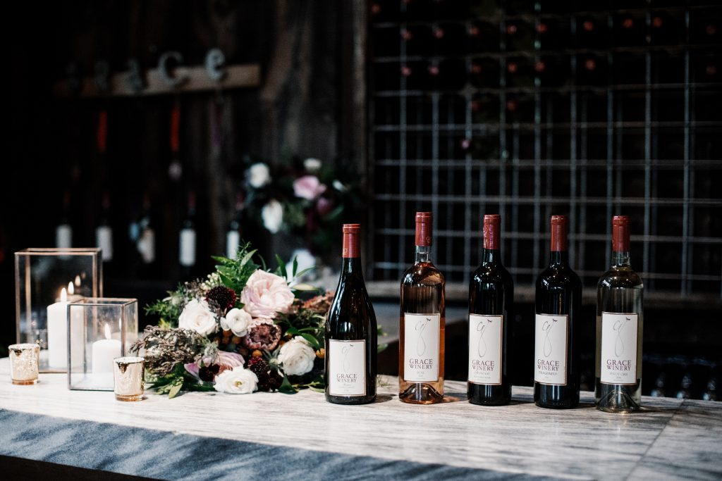 Photo of 5 bottles of wine on a table at grace winery