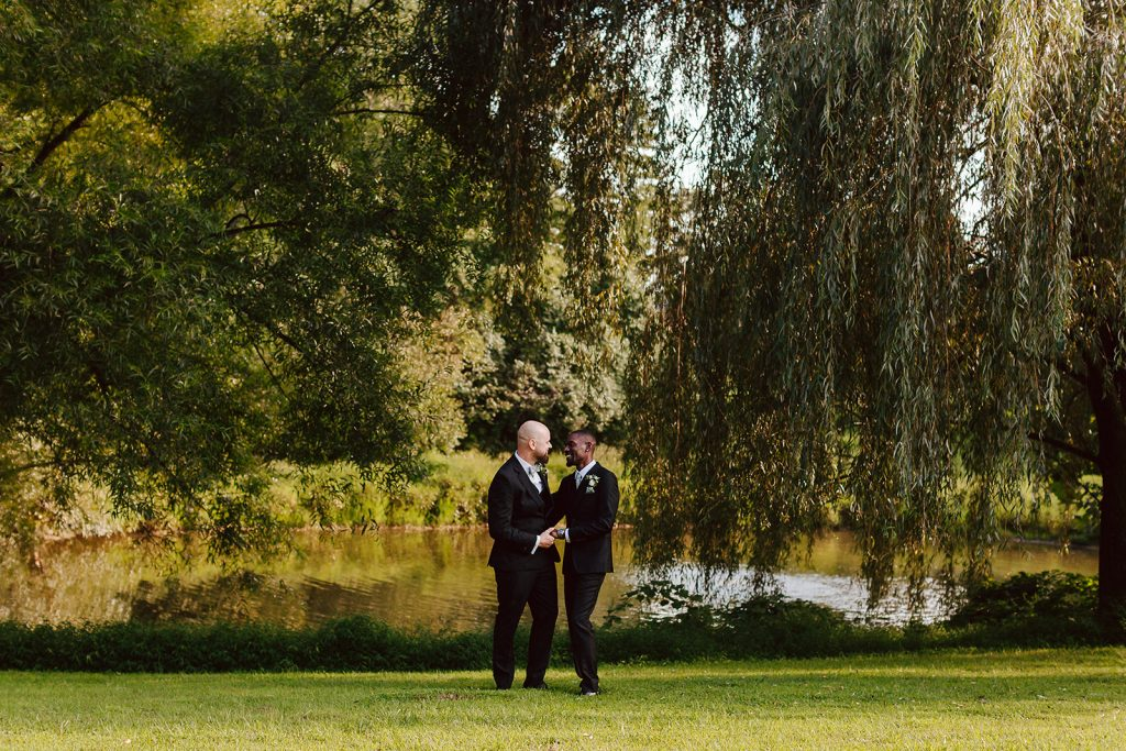 Photo of two men by the lake at Grace Winery
