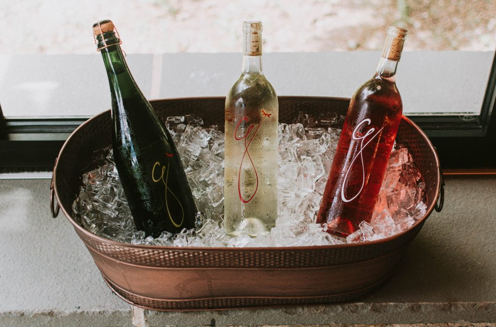 Photo of 3 bottles of wine being chilled in a bucket at Grace Winery